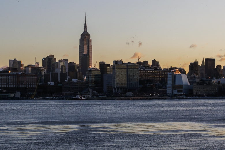 Ice floats along the Hudson River as the skyline of New York City and The Empire State Building are seen during freeze temperatures.