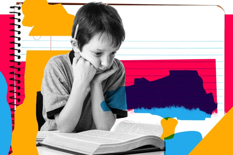 A boy, head in his hands and pencil in his right ear, stares at a huge book open in front of him.
