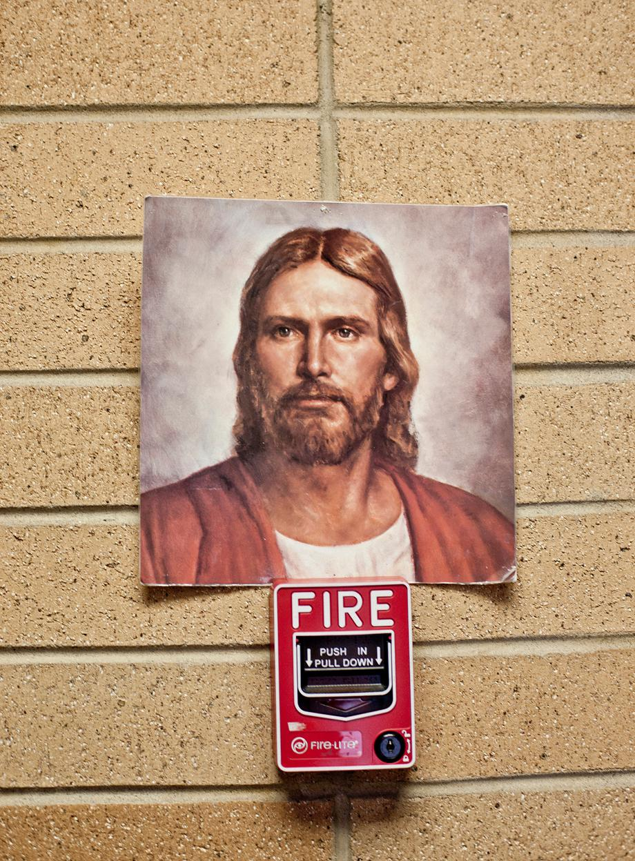 A picture of the most common representation of Jesus in the Mormon Church was stuck on top of a fire alarm at the Missionary Training Center where young men and women go to train for 3 months before leaving on their two year mission.