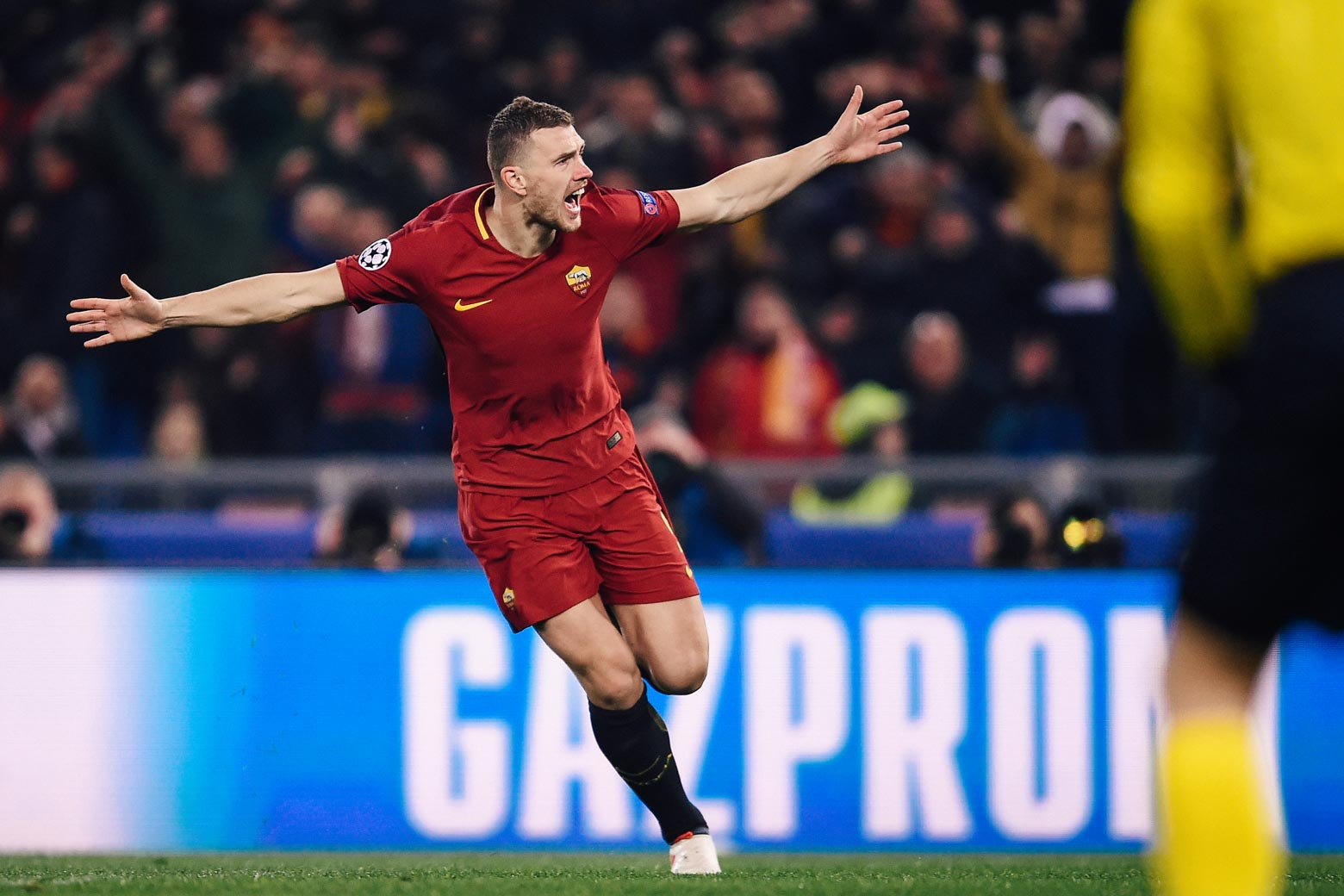 Roma's Bosnian striker Edin Džeko celebrates after scoring during the UEFA Champions League round of 16 second-leg football match against Shakhtar Donetsk on Tuesday at the Olympic Stadium in Rome.