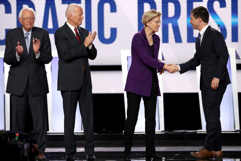 Democratic presidential candidates shake hands on stage before a presidential debate on Oct. 15, 2019 in Westerville, Ohio.