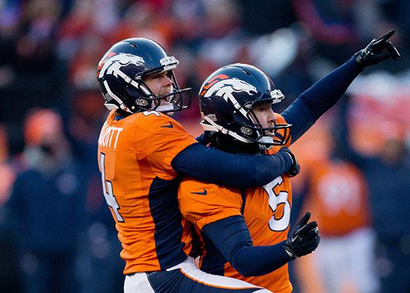 Place kicker Matt Prater #5 of the Denver Broncos celebrates a 64-yard field goal for a new NFL record.