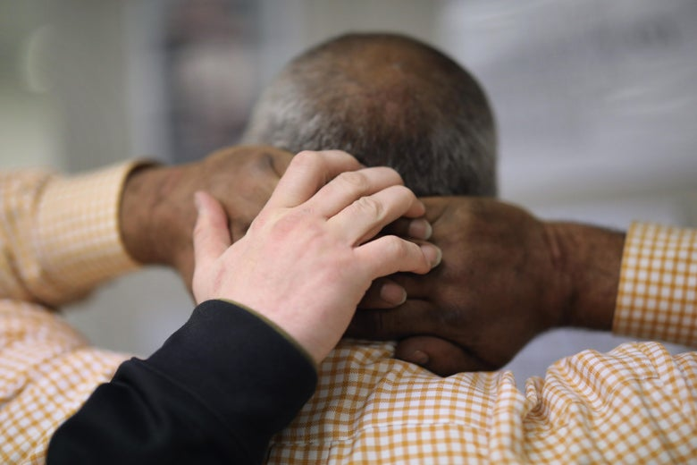 An Immigration and Customs Enforcement (ICE), officer frisks an immigrant at a processing center after arresting him on April 11, 2018.