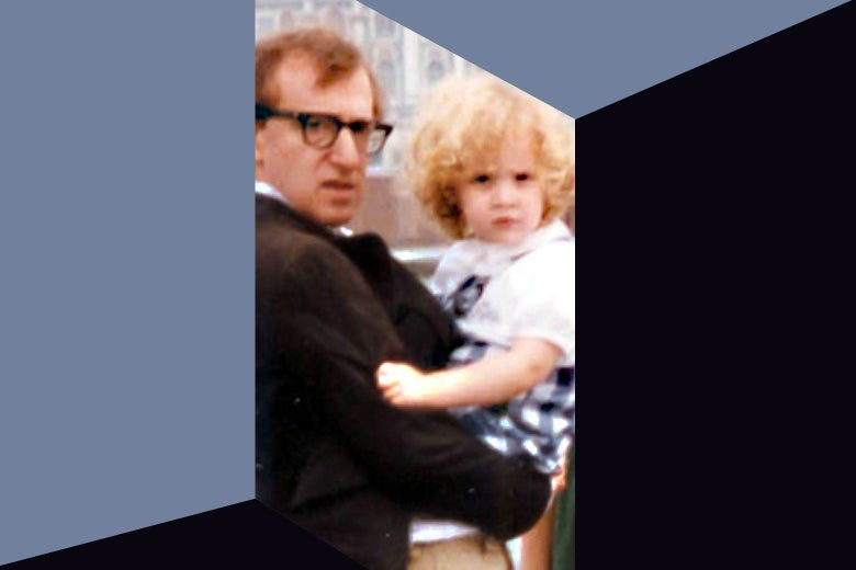 Woody Allen holding a young Dylan Farrow.