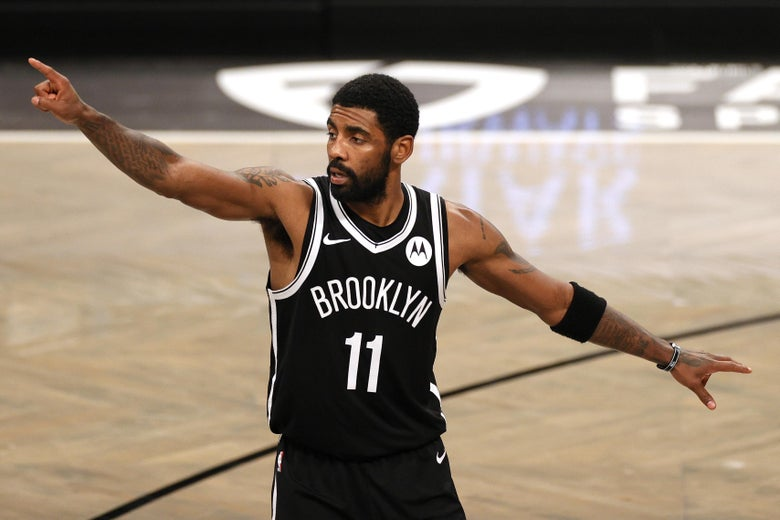 Kyrie Irving of the Brooklyn Nets points during an NBA game.