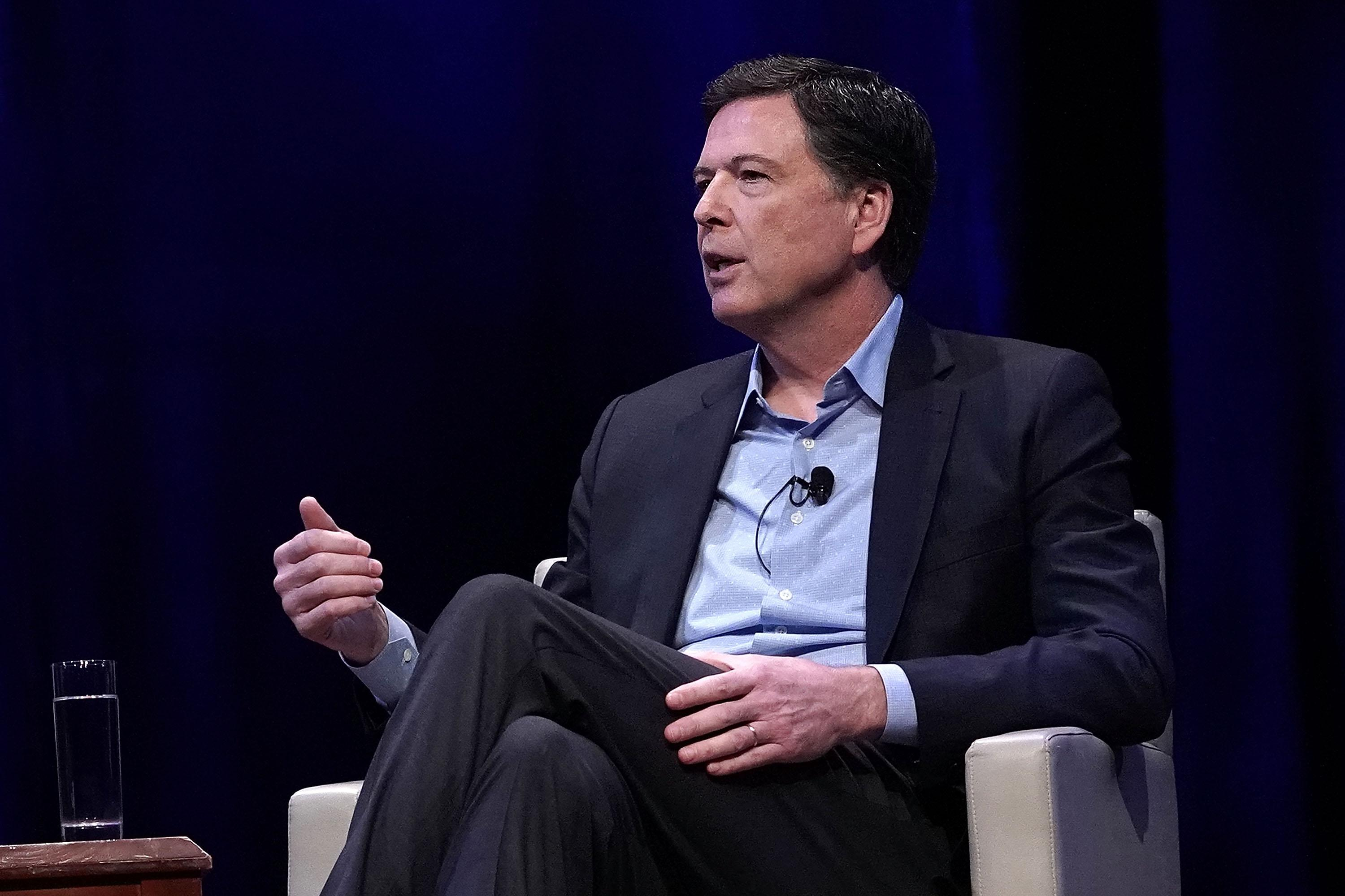 Former FBI Director James Comey talks at George Washington University on April 30 in Washington.
