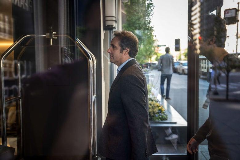 Cohen enters a hotel.