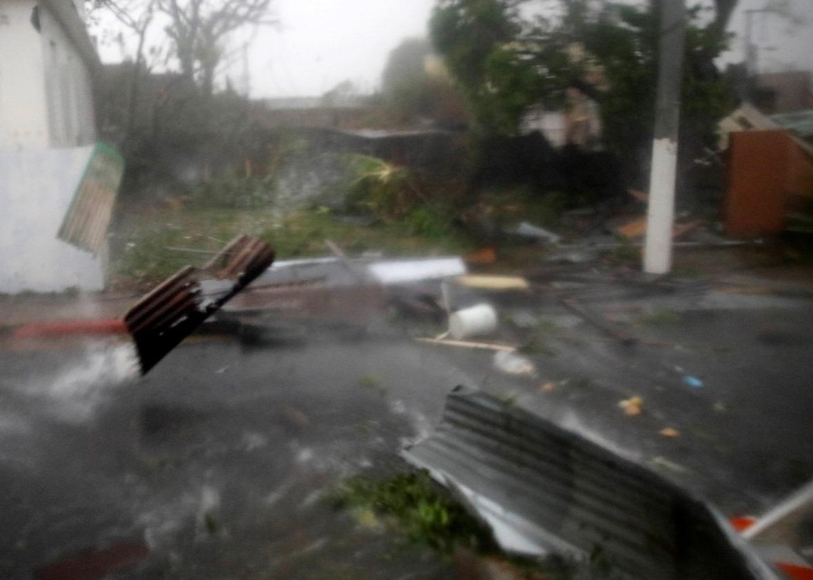 Constructions debris are carried by the wind after the area was hit by Hurricane Maria in Guayama, Puerto Rico September 20, 2017.