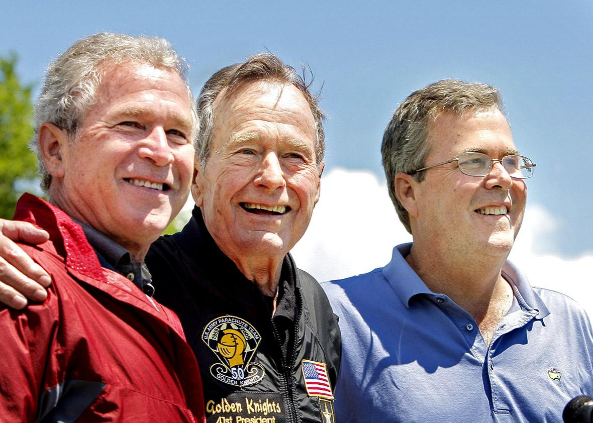 Former President George H. W. Bush poses with his sons former Pr