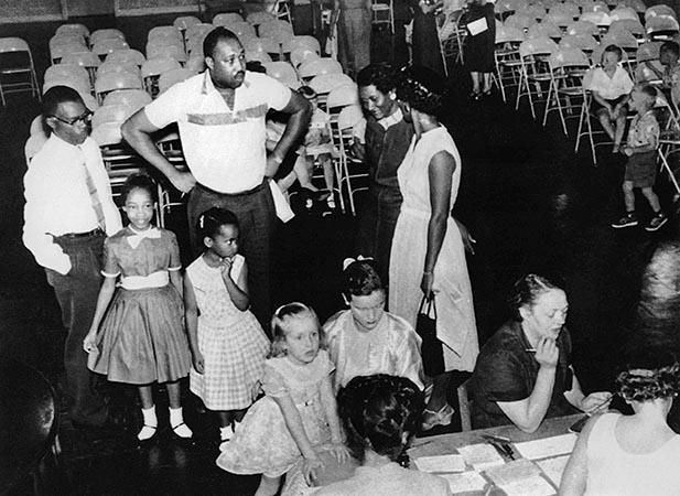 Two black parents wait in line to enroll their children in the first grade at a previously all-white city school in Nashville, August 27, 1957.