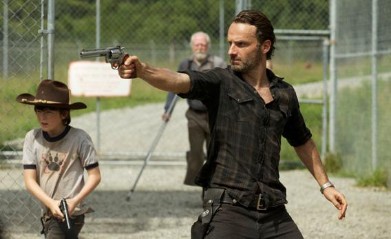 Carl Grimes (Chandler Riggs) and Rick Grimes (Andrew Lincoln), Hershel Greene (Scott Wilson).