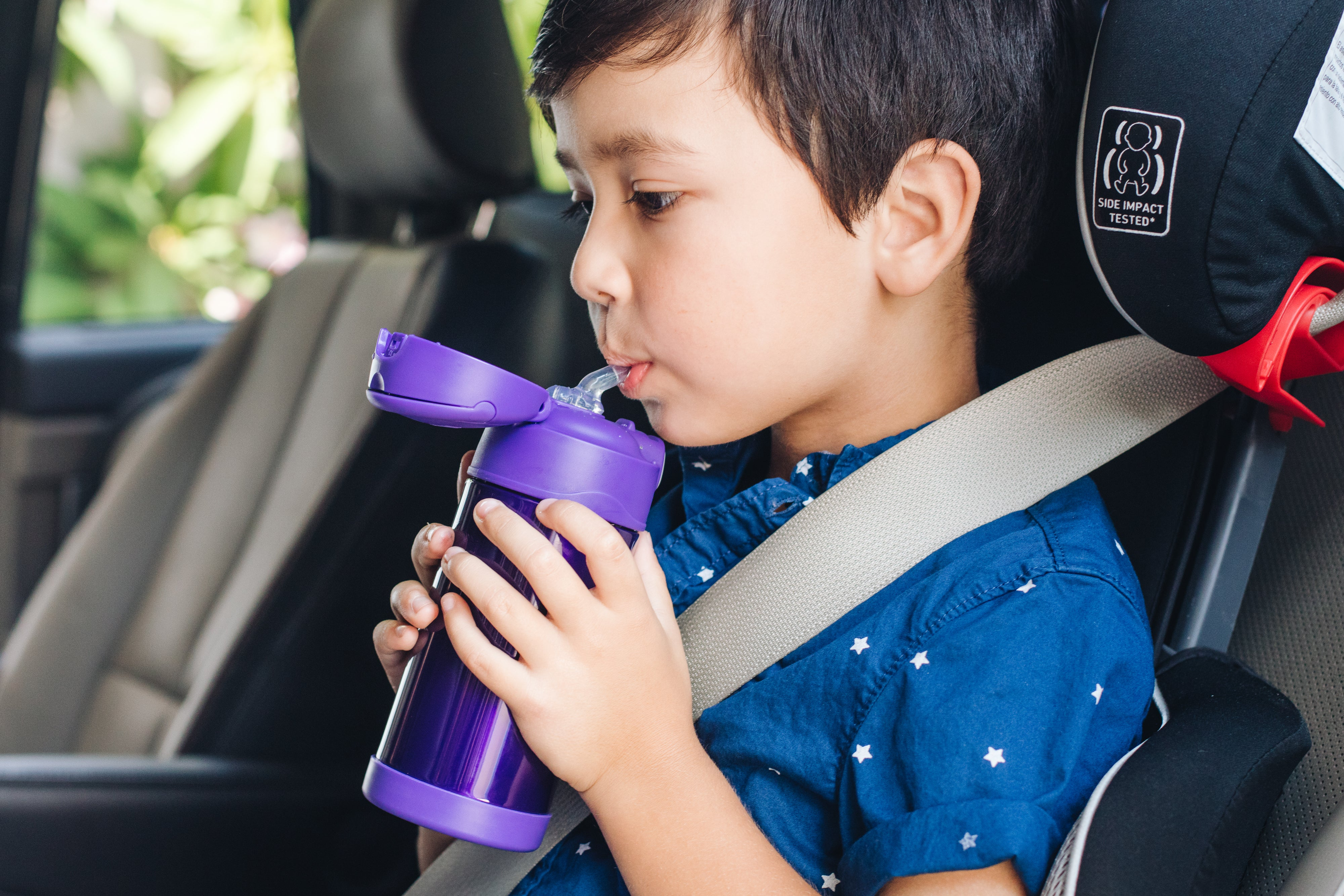 Child drinking from Thermos Funtainer