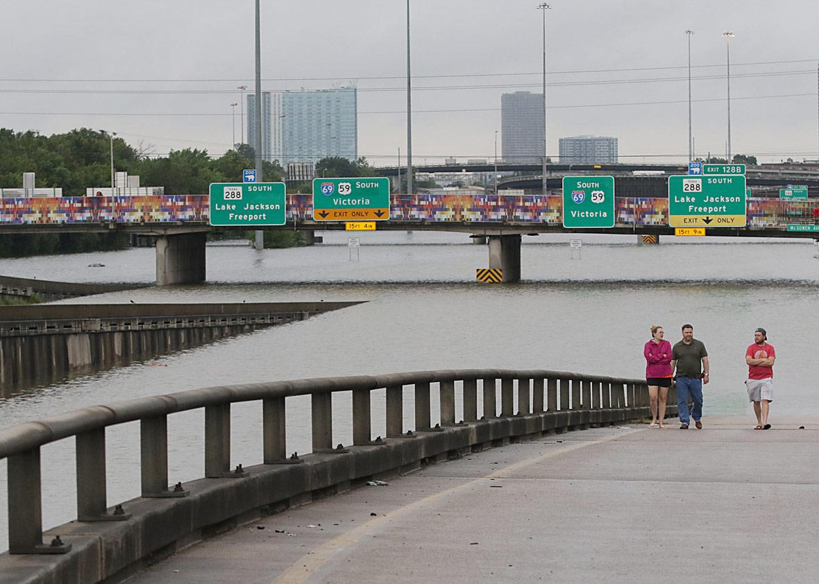 People view the flooded highways in Houston on August 27, 2017