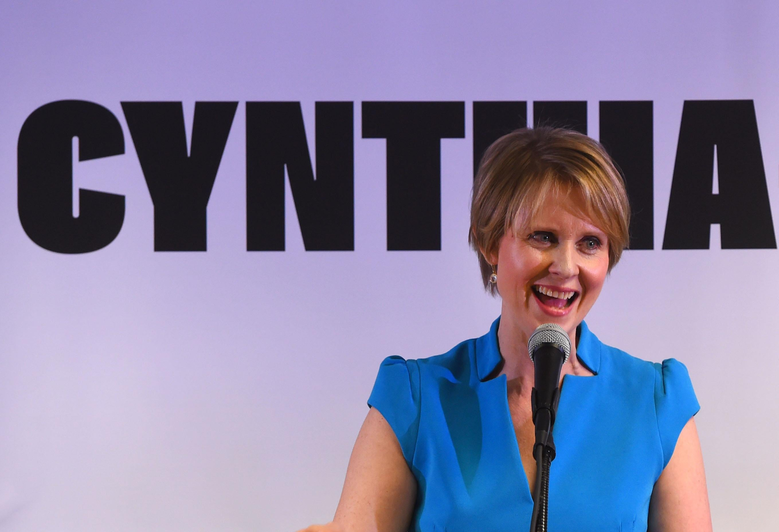 Former Sex and the City star Cynthia Nixon speaks to people at the Bethesda Healing Center in  Brooklyn, New York on March 20, 2018 at her first event since announcing that shes running for governor of New York.         Cynthia Nixon, the US actress who shot to fame as workaholic lawyer Miranda on 'Sex and the City,' jumped into the race for New York governor March 19, 2018, unveiling a progressive platform championing economic equality and eschewing big business.The 51-year-old declared her candidacy with a two-minute campaign video posted on Twitter that showed her at home with her wife and children, riding the subway, taking one of her children to school and speaking at liberal political causes.          / AFP PHOTO / TIMOTHY A. CLARY        (Photo credit should read TIMOTHY A. CLARY/AFP/Getty Images)