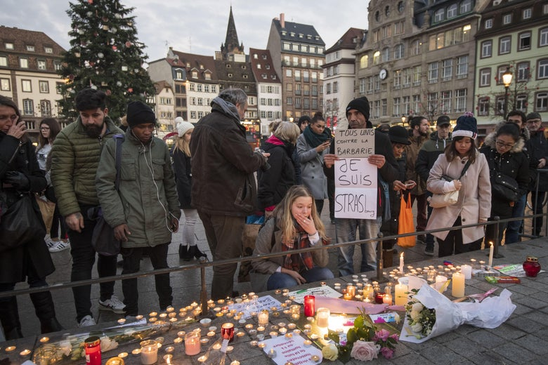 Mourners leave candles in a square in Strasbourg.