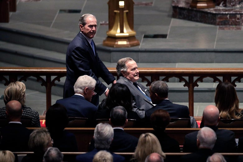 Former Presidents George W. Bush and George H.W. Bush arrive as they pass by former first lady Hillary Clinton, former President Bill Clinton, former first lady Michelle Obama, former President Barack Obama and first lady Melania Trump at St. Martin's Episcopal Church for a funeral service for former first lady Barbara Bush, April 21, 2018 in Houston, Texas.