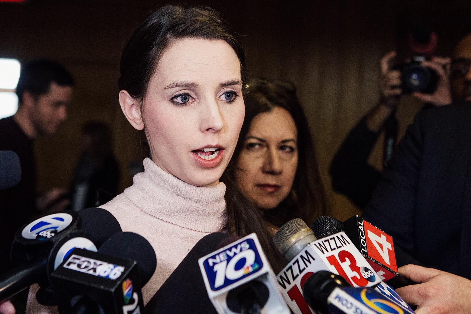Rachael Denhollander addresses the media following the sentencing of Larry Nassar on Feb. 5 in Charlotte, Michigan.