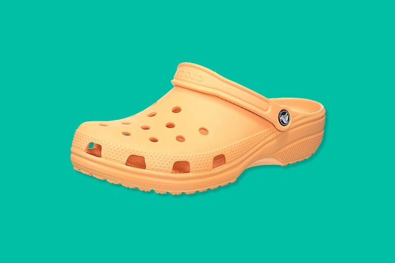 A single Crocs sandal in a cantaloupe color