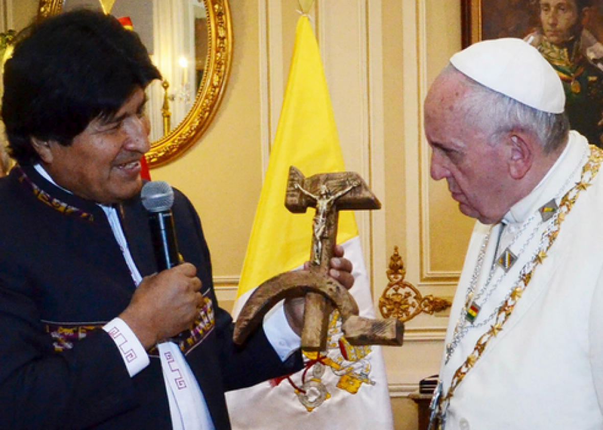 Bolivian president Evo Morales handing Pope Francis a communist crucifix on July 8.