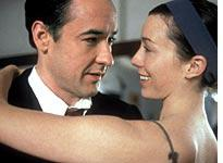 John Cusack and Molly Parker dance with danger