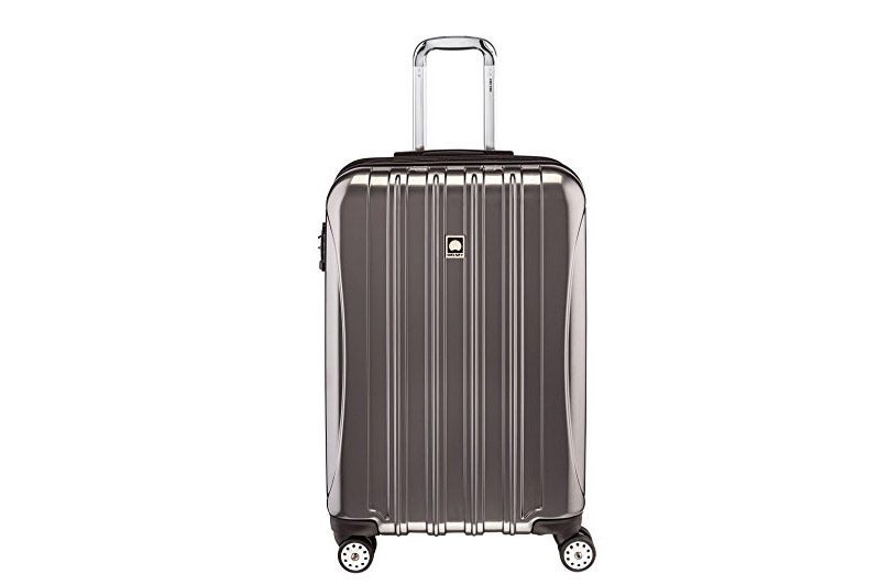 "Delsey Helium Aero 25"" Expandable Spinner Trolley."