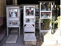 Aluminum cases serve as makeshift shrines to fallen soldiers