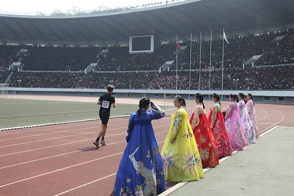Will Philipps completes the marathon in the 50,000-seat stadium.