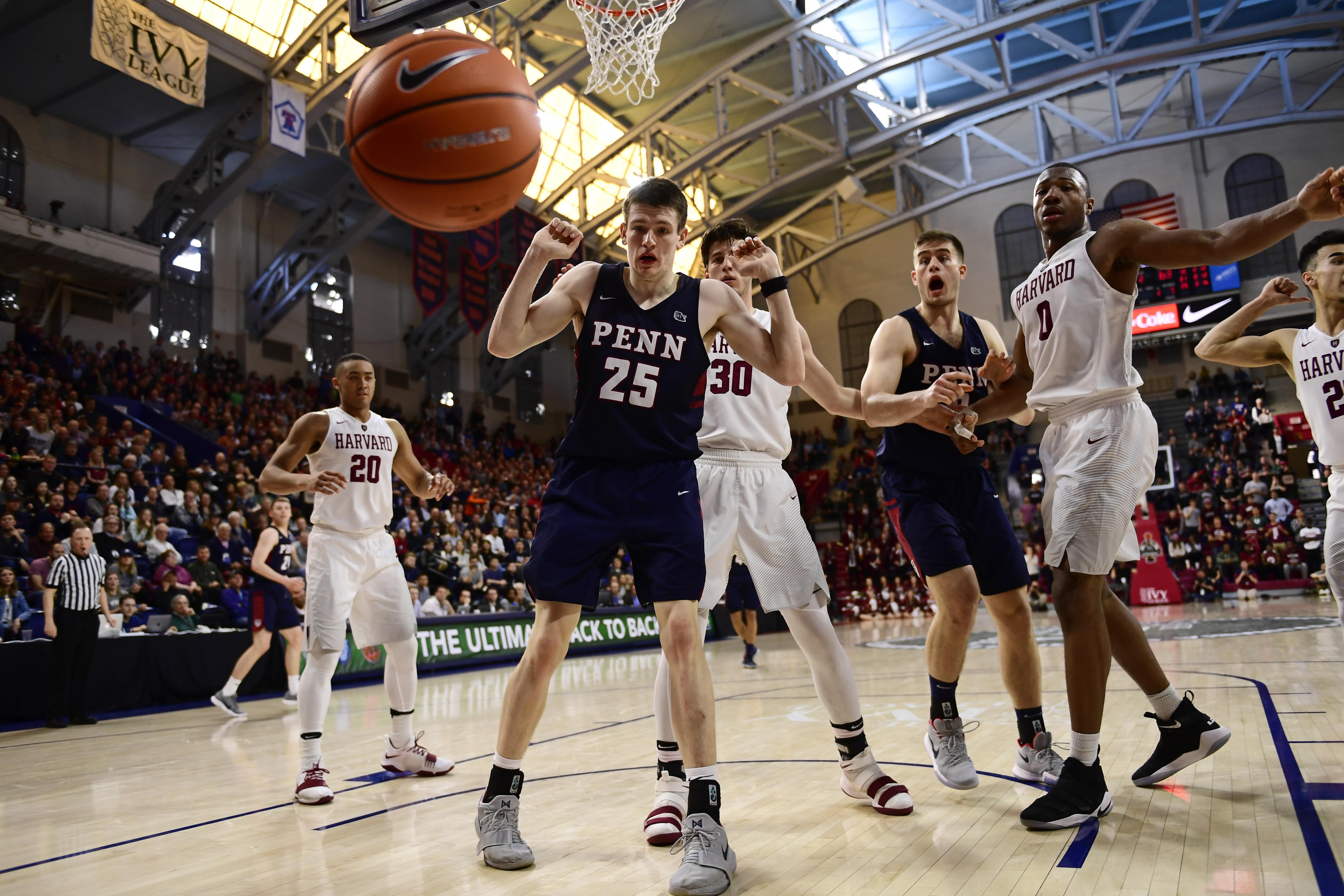 PHILADELPHIA, PA - MARCH 11: (L-R) AJ Brodeur #25 of the Pennsylvania Quakers Danilo Djuricic #30 of the Harvard Crimson Max Rothschild #0 of the Pennsylvania Quakers and Chris Lewis #0 of the Harvard Crimson watch the ball bounce out of bounds during the second half of the Men's Ivy League Championship Tournament at The Palestra on March 11, 2018 in Philadelphia, Pennsylvania. Penn defeated Harvard 68-65. (Photo by Corey Perrine/Getty Images)