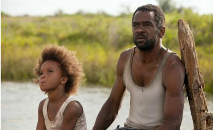 "Quvenzhane Wallis as ""Hushpuppy"" and Dwight Henry as ""Wink"" in Beats of the Southern Wild."