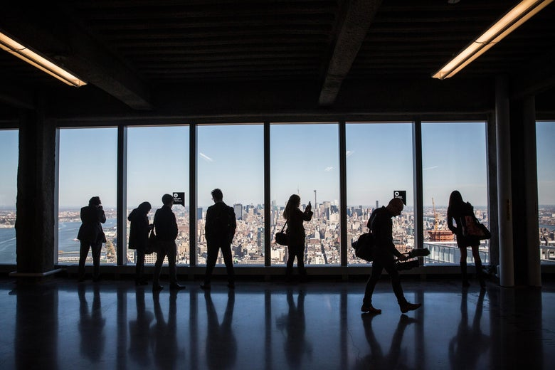 Members of the media explore a model office, used to exhibit what a business space could look like on the 63rd floor of  One World Trade Center, which opens for business today, on November 3, 2014 in New York City.