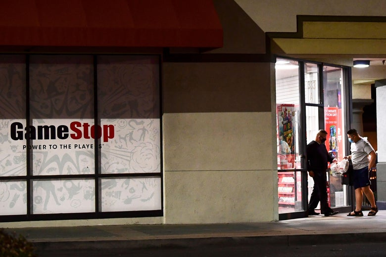 Customers step out of a GameStop store in Alhambra, California.