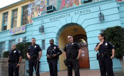 Police stand outside Miramonte Elementary School in Los Angeles, California February 6, 2012.