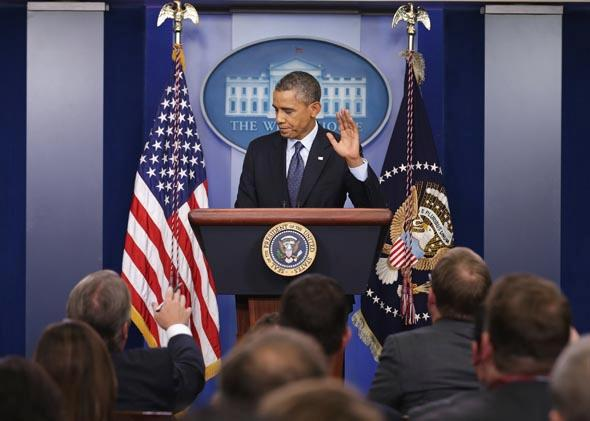 U.S. President Barack Obama waves at the conclusion of a press conference in the Brady Press Briefing Room of the White House on October 8, 2013 in Washington, DC.