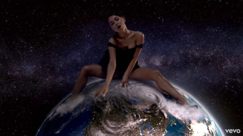 Ariana Grande straddles planet Earth.