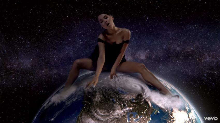 Ariana Grande straddles planet Earth.