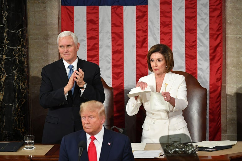 Vice President Mike Pence claps as House Speaker Nancy Pelosi rips a copy of President Donald Trump's State of the Union in Washington, DC.