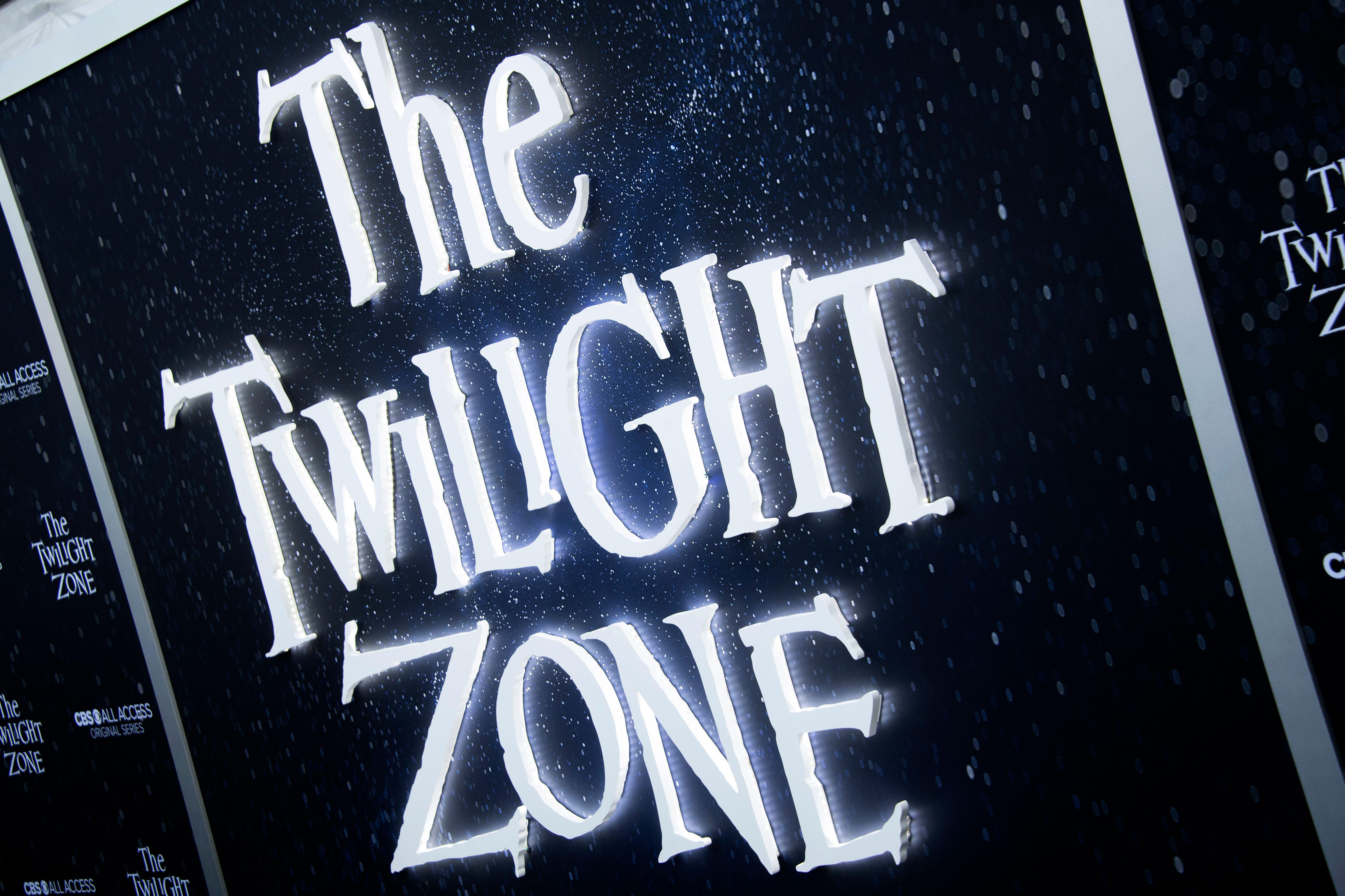 A sign on the red carpet at the premiere of the Twilight Zone displays the show's original logo.
