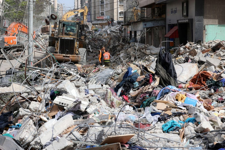 An excavator clears the rubble of a destroyed building in Gaza City's Rimal residential district on May 16, 2021, following massive Israeli bombardment on the Hamas-controlled enclave.