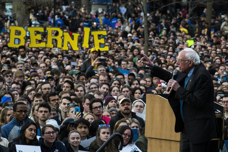 Bernie Sanders giving a speech to a large crowd.