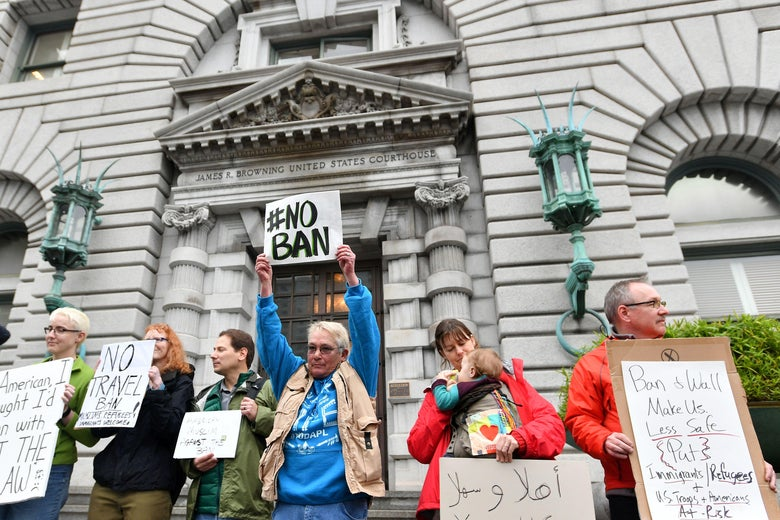 Protesters stand in front of the United States Court of Appeals for the Ninth Circuit in San Francisco, California on February 7, 2017.          A federal appeals court heard arguments on Tuesday on whether to lift a nationwide suspension of President Donald Trump's travel ban targeting citizens of seven Muslim-majority countries. / AFP / Josh Edelson        (Photo credit should read JOSH EDELSON/AFP/Getty Images)