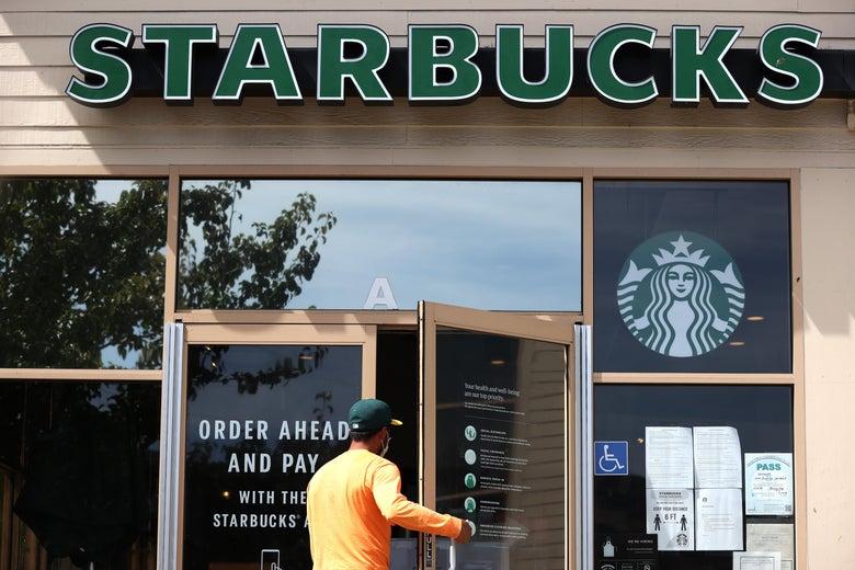 A customer enters a Starbucks Coffee store in San Rafael, California.