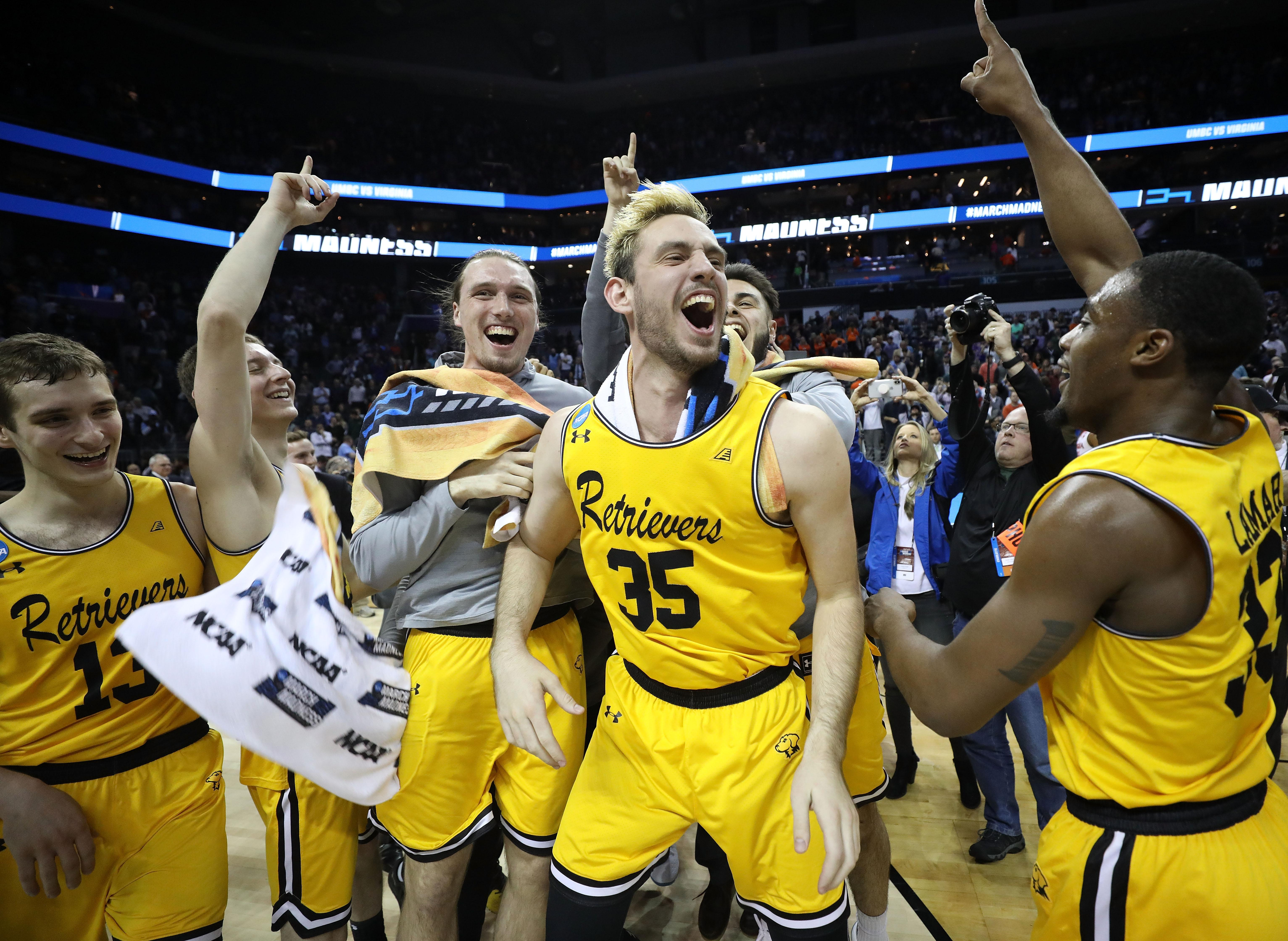 CHARLOTTE, NC - MARCH 16:  The UMBC Retrievers bench reacts to their 74-54 victory over the Virginia Cavaliers during the first round of the 2018 NCAA Men's Basketball Tournament at Spectrum Center on March 16, 2018 in Charlotte, North Carolina.  (Photo by Streeter Lecka/Getty Images)