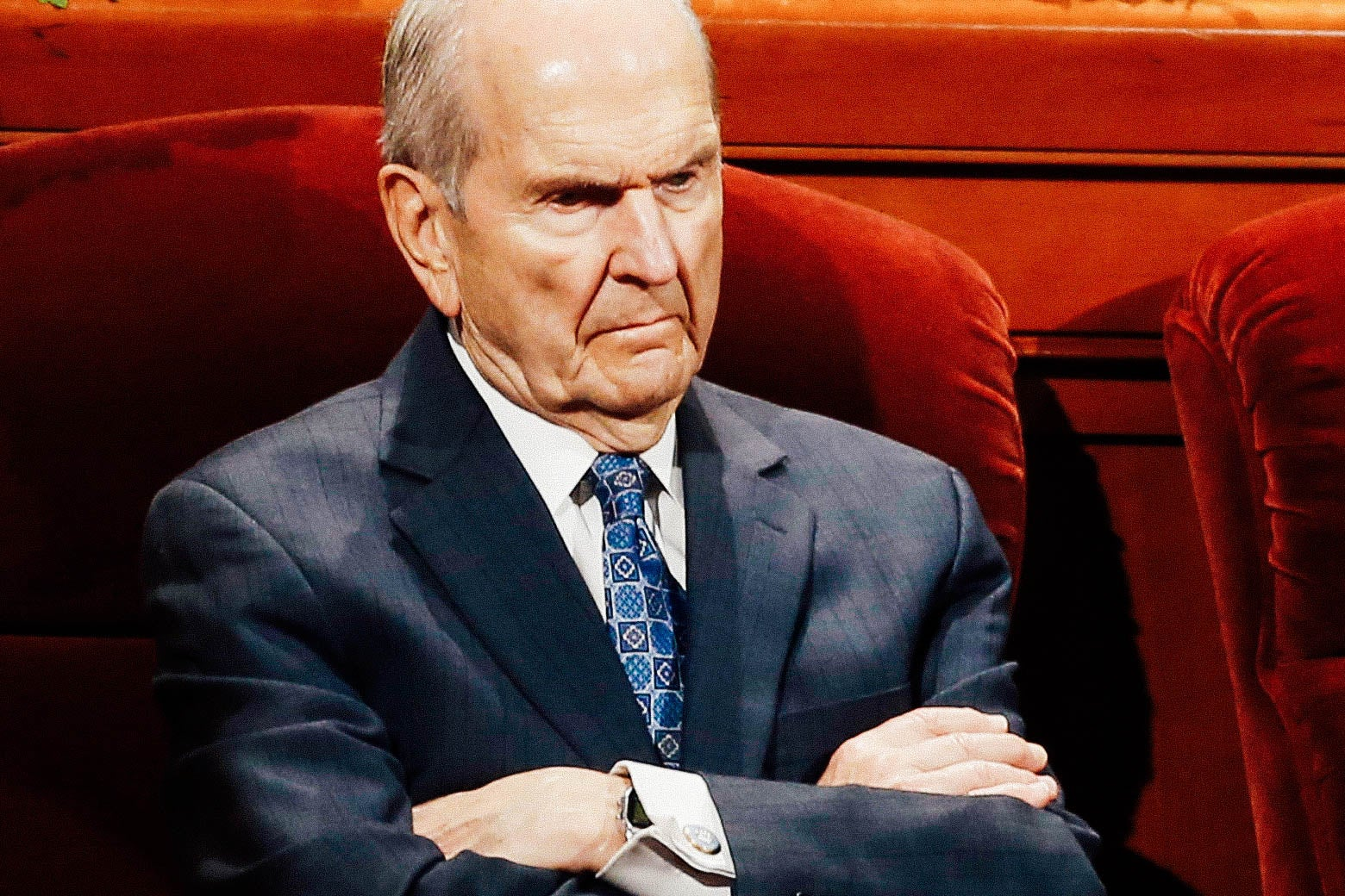 Russell Nelson seated, with his arms crossed.