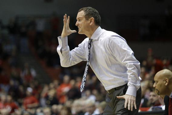 Rutgers head coach Mike Rice in action against Cincinnati in an NCAA college basketball game.
