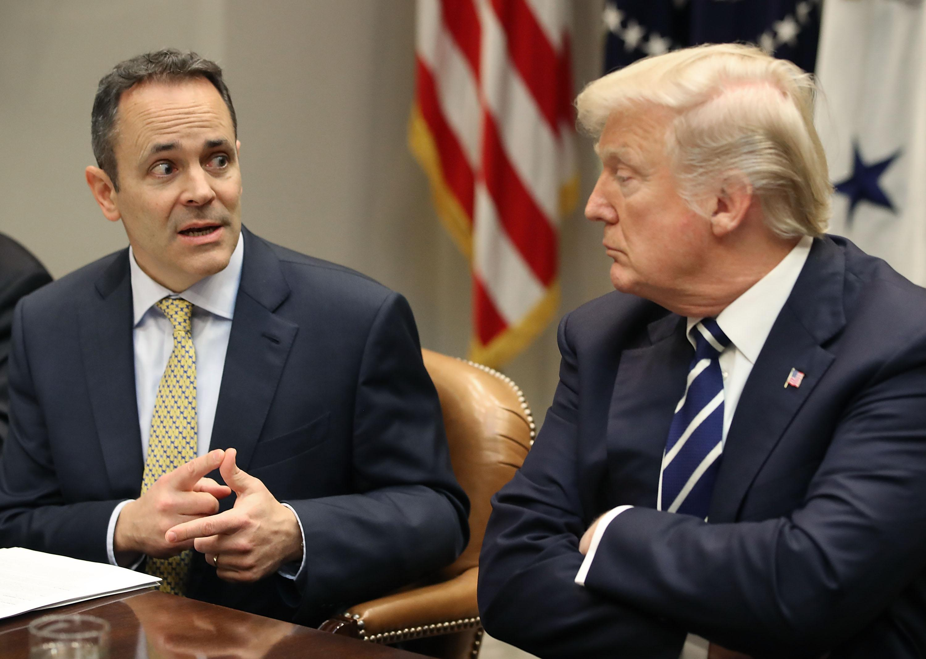 President Donald Trump listens to Kentucky Governor Matt Bevin speak at the White House, on January 11, 2018 in Washington, DC.