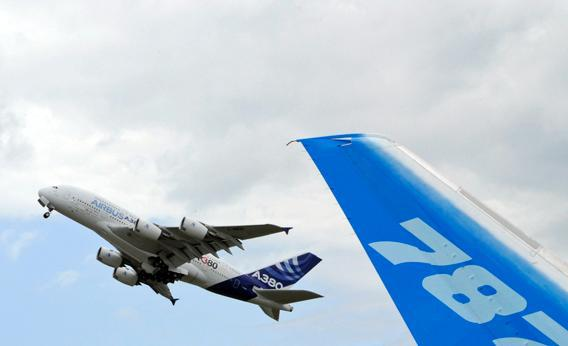 The vertical stabilizer of a Boeing 787 Dreamliner is seen as an Airbus A380.