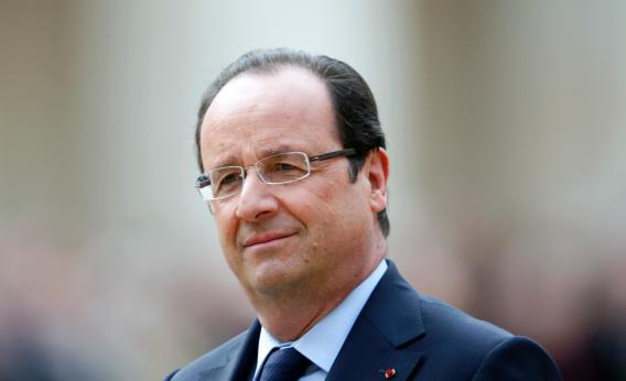France's President Francois Hollande attends a military ceremony in the courtyard of the Invalides in Paris, on June 14, 2013.