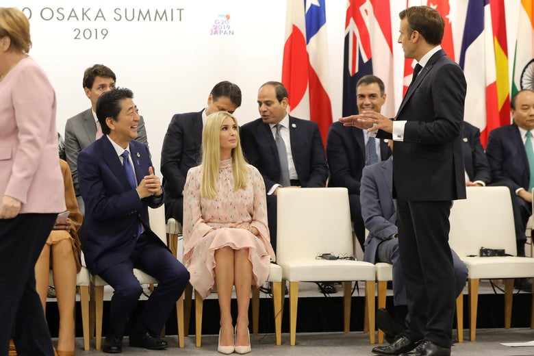 "Ivanka Trump listens to Japan's Prime Minister Shinzo Abe (L) and France's President Emmanuel Macron (R) talk at an event on the theme ""Promoting the place of women at work"" on the sidelines of the G20 Summit in Osaka on June 29, 2019."