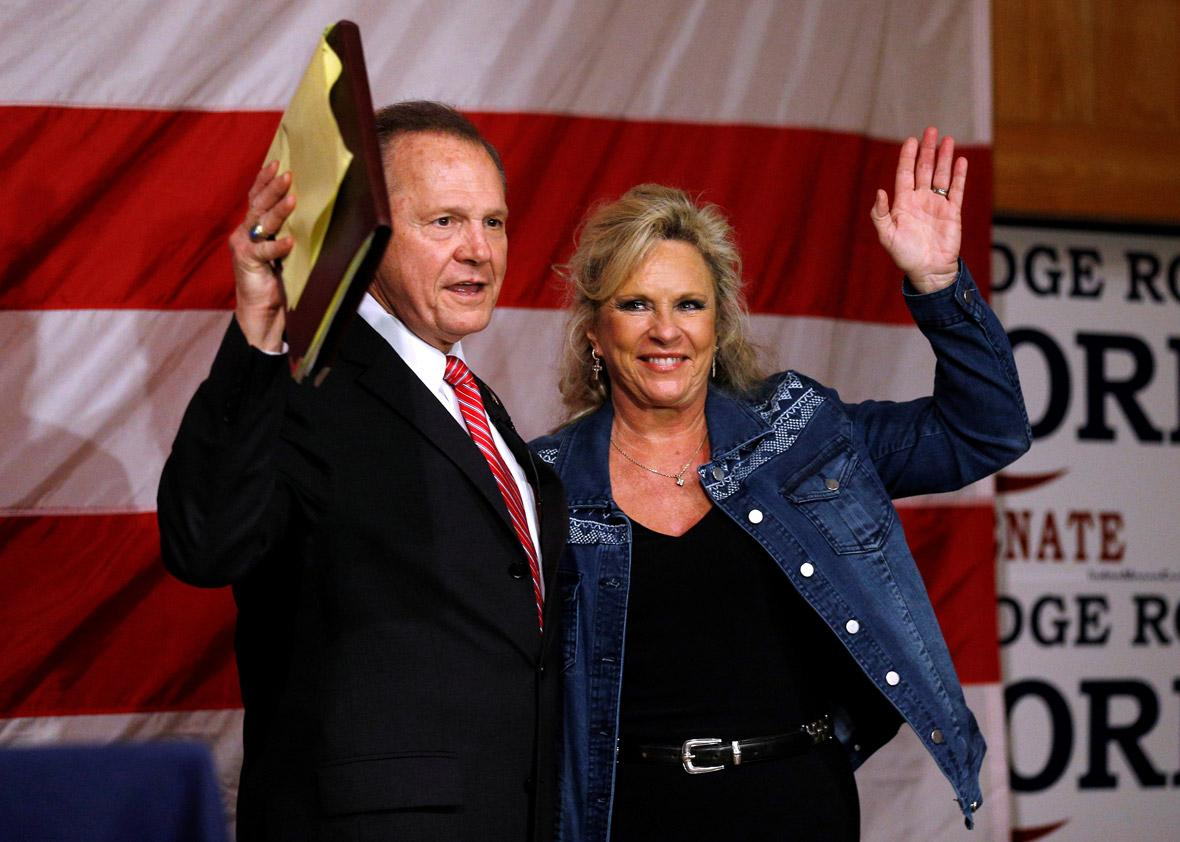 Republican candidate for U.S. Senate Judge Roy Moore and his wife Kayla wave to the crowd during a campaign rally in Fairhope, Alabama, U.S., December 5, 2017.