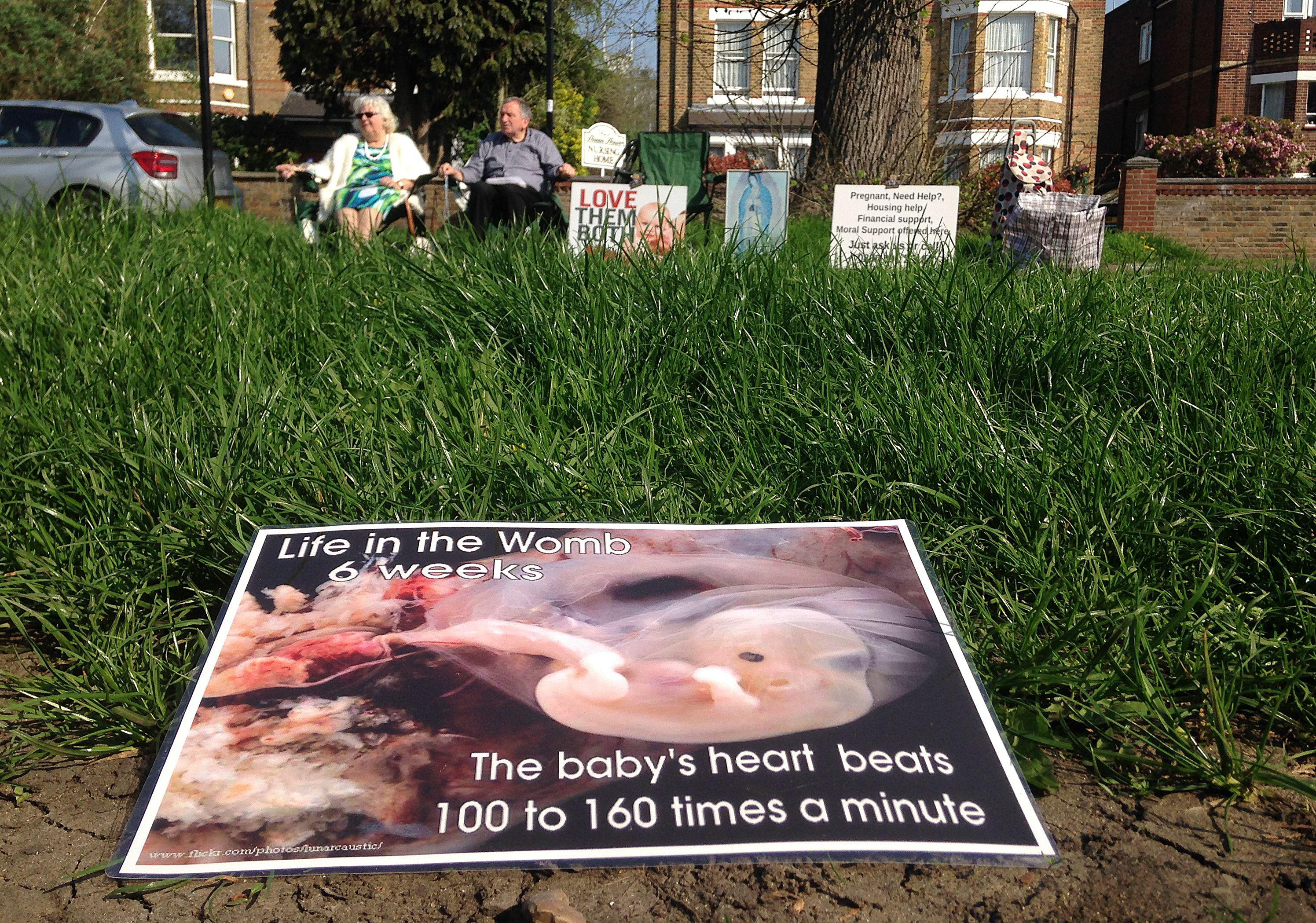 Colleen Wallace (L) and Eamonn Gill, who oppose abortion attend a pro-life vigil on the street outside the Marie Stopes clinic, that offers contraception and abortion services, in Ealing, west London, on April 21, 2018. - A ban on pro-life protests outside an abortion clinic in London came into force on Monday in a first that pro-choice campaigners hope will set a precedent for the country. (Photo by ALICE RITCHIE / AFP)        (Photo credit should read ALICE RITCHIE/AFP/Getty Images)